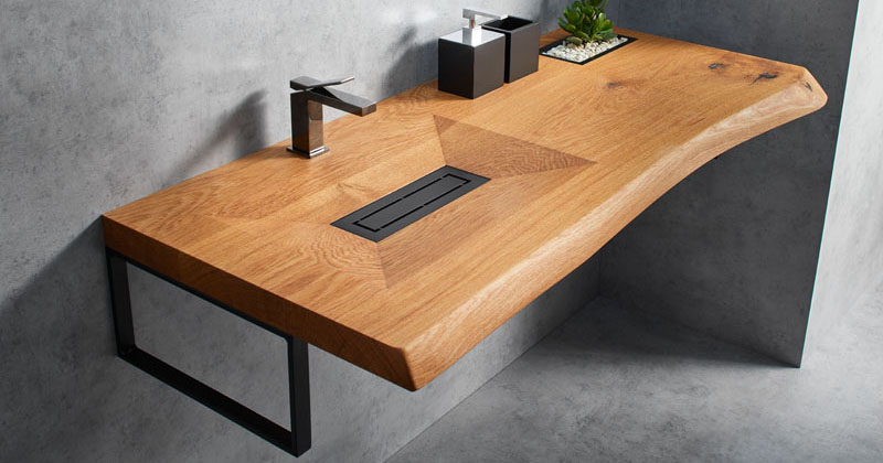 This Wood Vanity Has A Carved Out Sink And A Built In