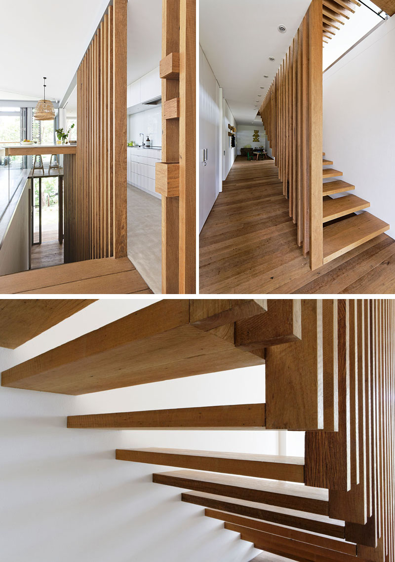 Tucked away between the living room and the kitchen in this modern house, are suspended wood stairs that lead down to the bedrooms. #SuspendedStairs #StairDesign #WoodStairs