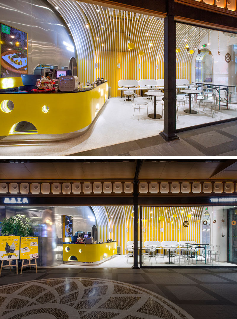 A bright yellow cheese-like bar complements the yellow walls and draws attention of people passing by. #CafeDesign #InteriorDesign #ModernCafe