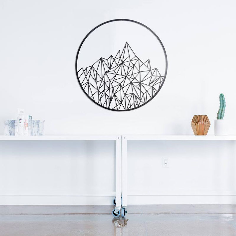 ArcliteFabrication have created metal wall art that showcases a geometric pattern resembling mountains. #MountainWallArt #MountainArt #MountainDecor #MetalWallArt