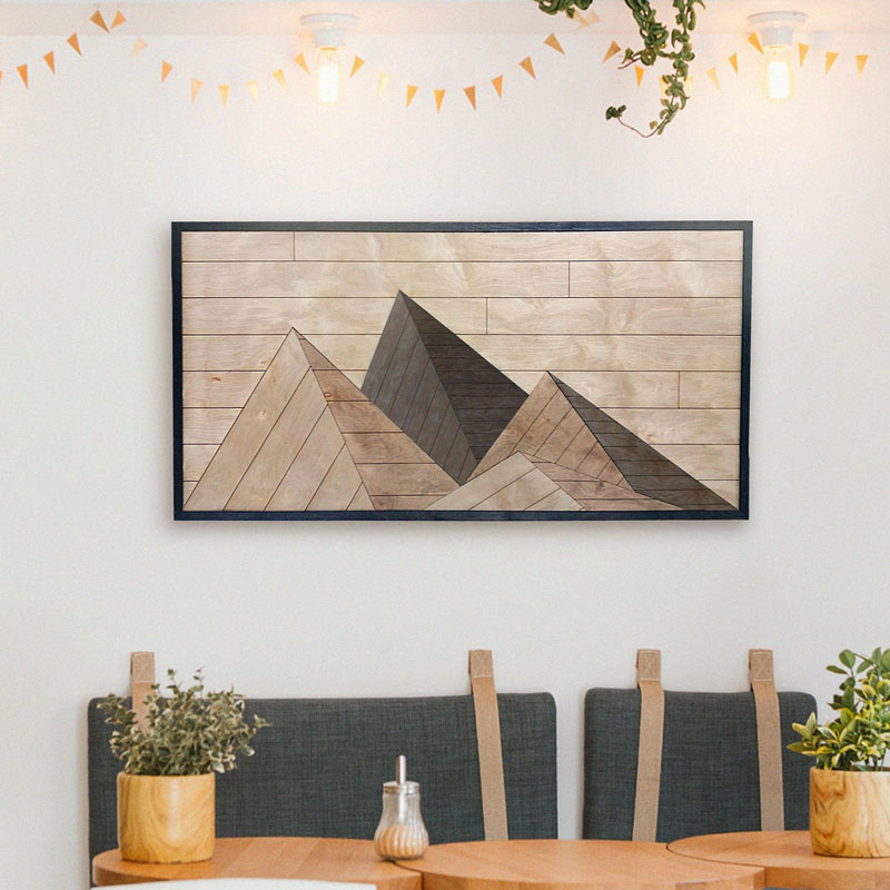 This modern mountain wall art is made from panels of sustainably sourced hardwood veneer and recycled wood products, hand-finished with a mix of natural wood stains. #MountainWallArt #MountainArt #MountainDecor #WoodWallArt