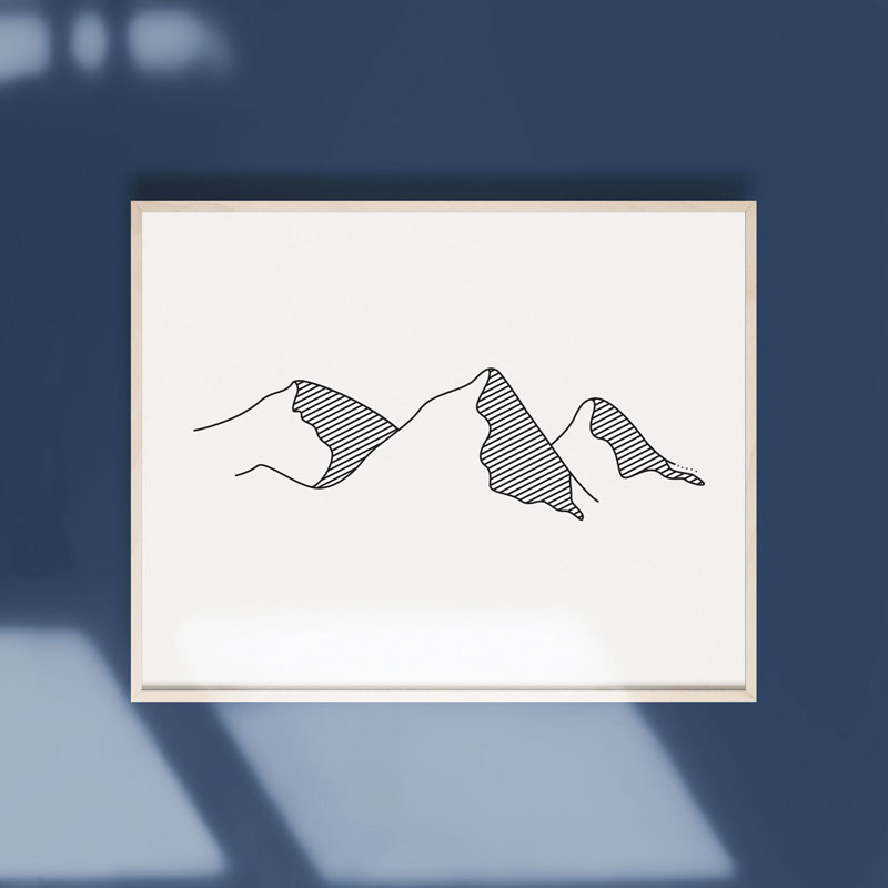 This minimalist line print of mountains is a simple way to bring a little nature inside. #MountainWallArt #MountainArt #MountainDecor #MinimalistArt
