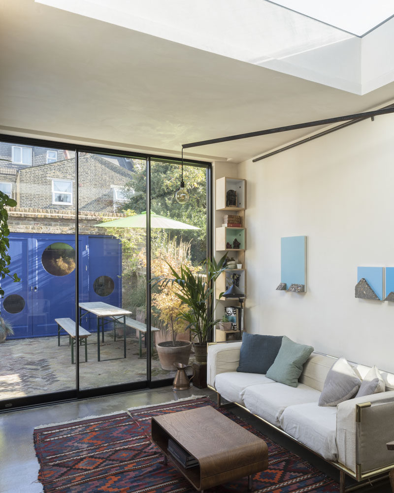 Floor-to-ceiling sliding doors open this living room to the patio outside, that provides additional living space and access to a small studio. #SlidingDoors #Patio #LivingRoom