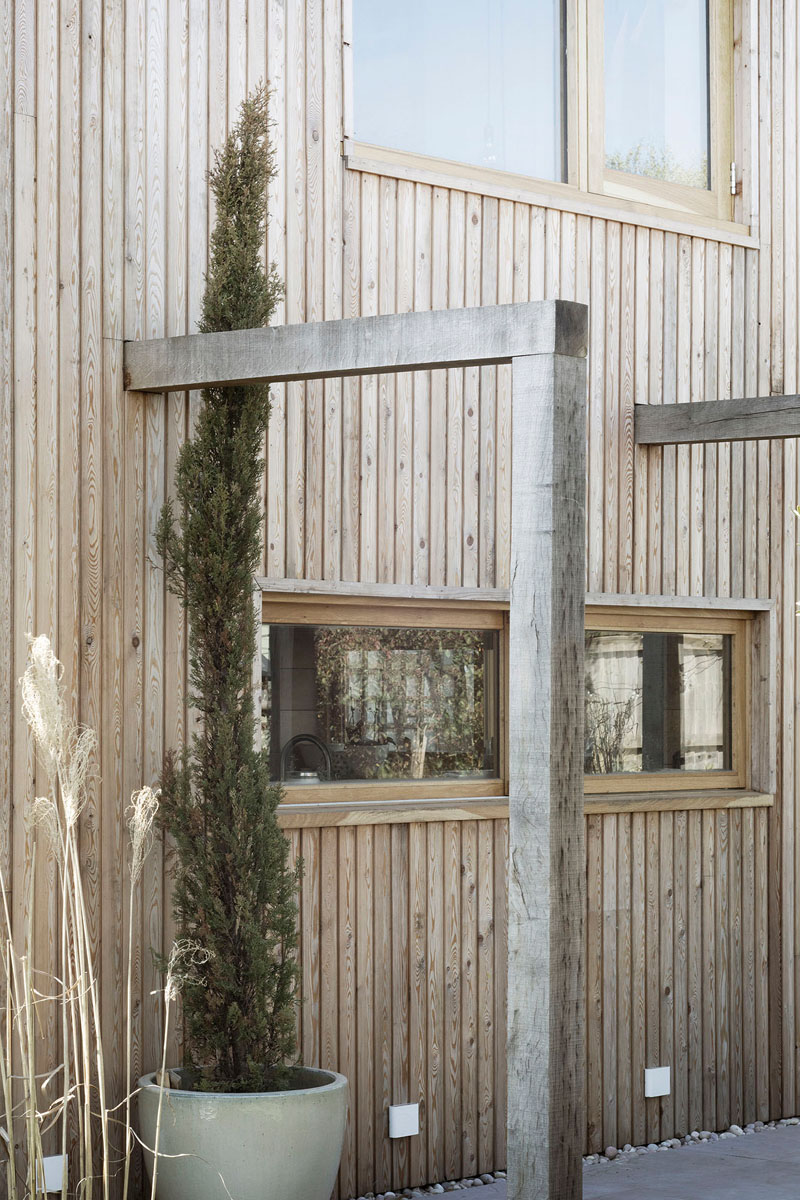 This contemporary house addition is covered in larch, a type of wood siding. #WoodSiding #TimberCladding #WoodExterior #WoodHouse