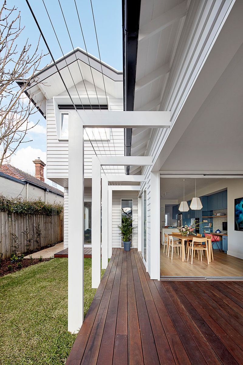 The dining room and the living room of this renovated house, both open up to the yard. A covered wood deck provides additional living space for the family. #Deck #Yard #Landscaping
