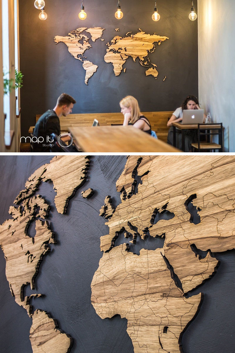 The designers of this modern world map used an African wood species that gives the art piece a golden color with darker grey streaks and veins.