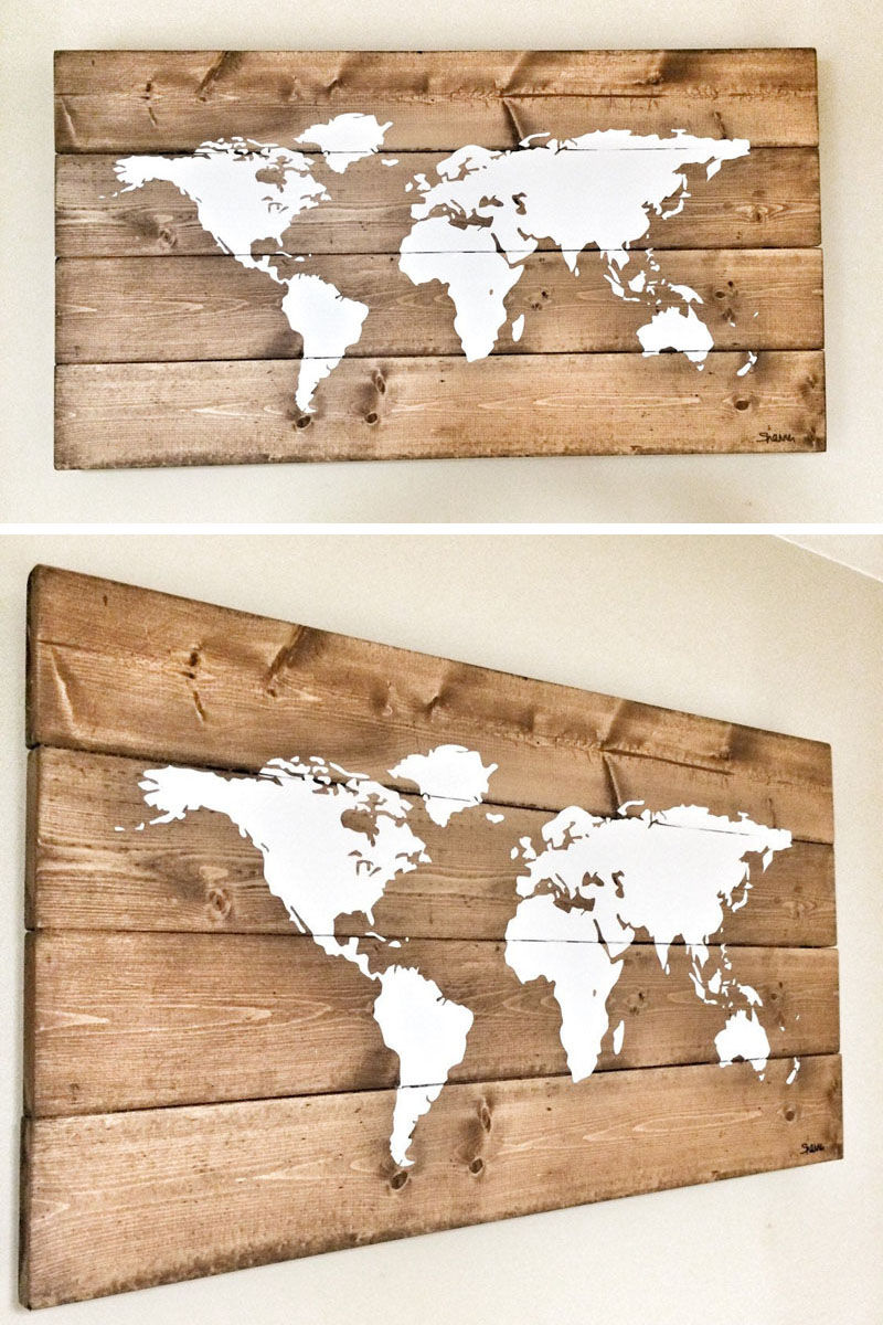 This rustic wood world map has a white hand-painted map, and due to the wood used, users can easily place push pins to show all their travels.
