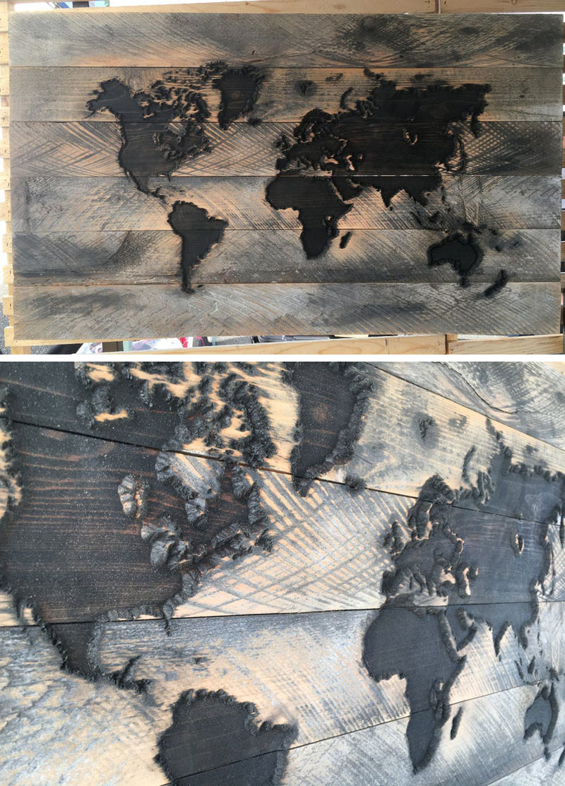 This world map wall art is made from reclaimed wood, which has then been carved with the design.