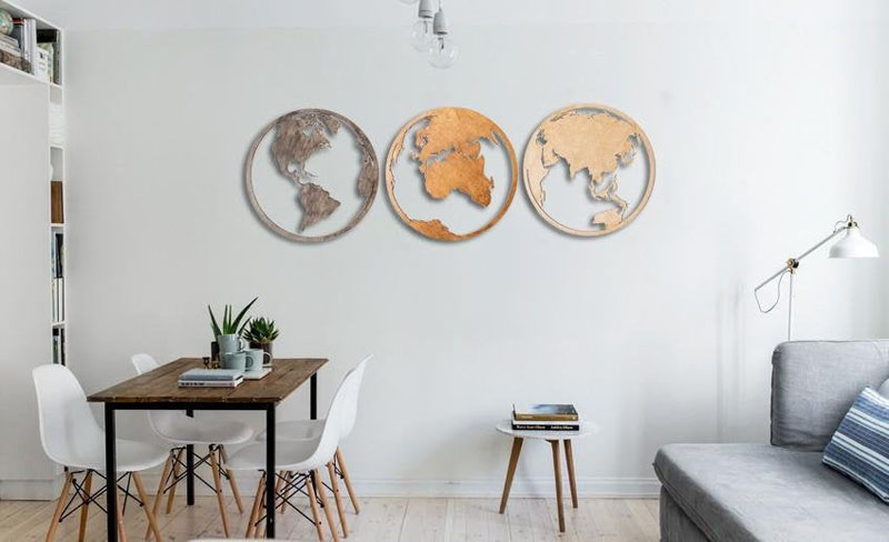 The designers of this wood world map, separated the various regions of the world into three circles.