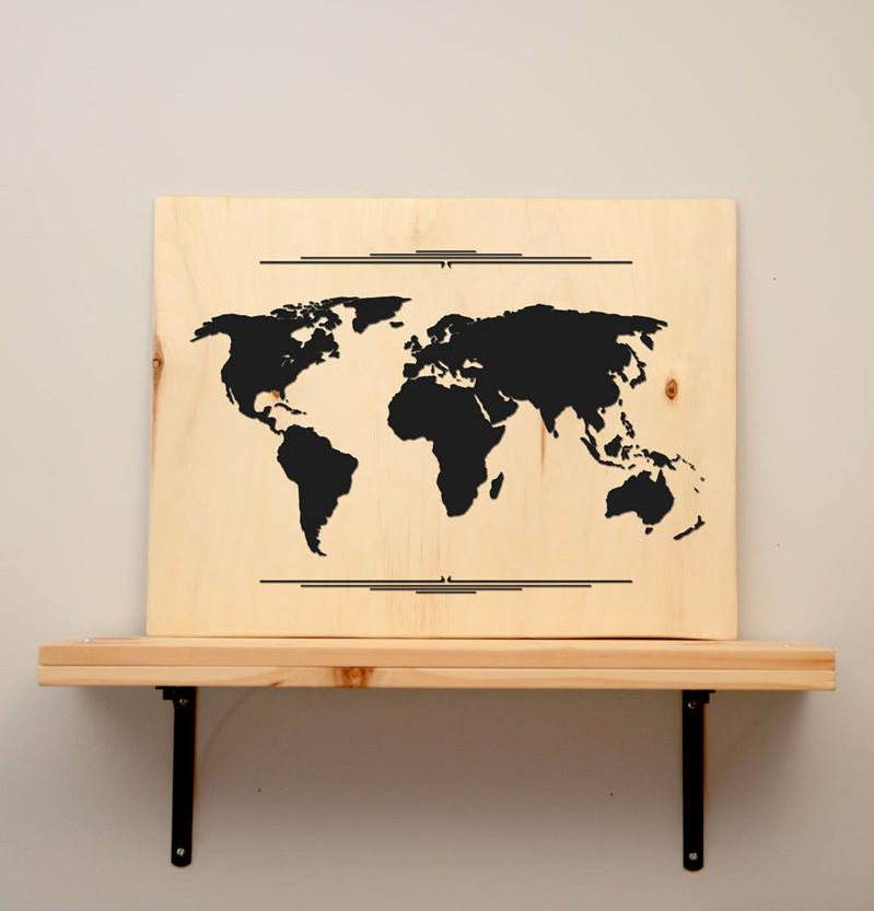 This custom cut world map has a minimalist black vinyl 'world map' that's placed on a piece of poplar/aspen plywood.