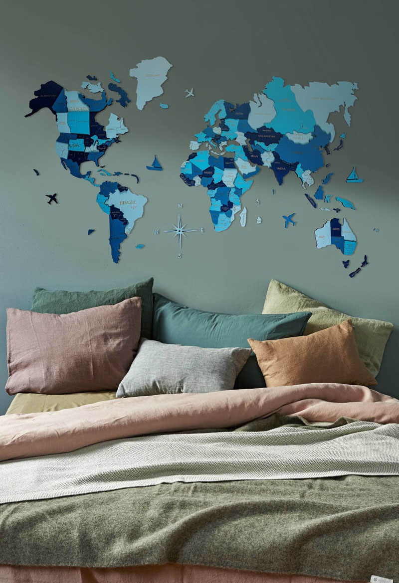 Different shades of blue make this eye-catching world map stand out on a plain wall.