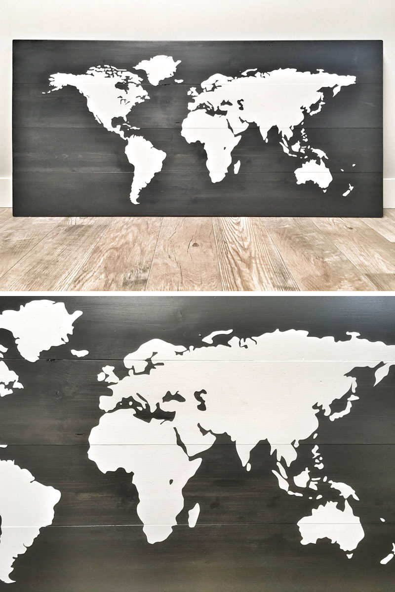 The wood of this world map wall art has been sanded smooth, stained in a black, hand painted white world map, and distressed by hand.
