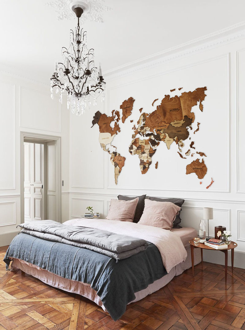 This large world map uses different shades of wood to highlight the various countries around the world.