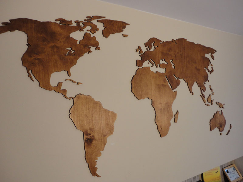 This large world wall map showcases the natural grain of the wood, which is highlighted by the use of colored wood oil.
