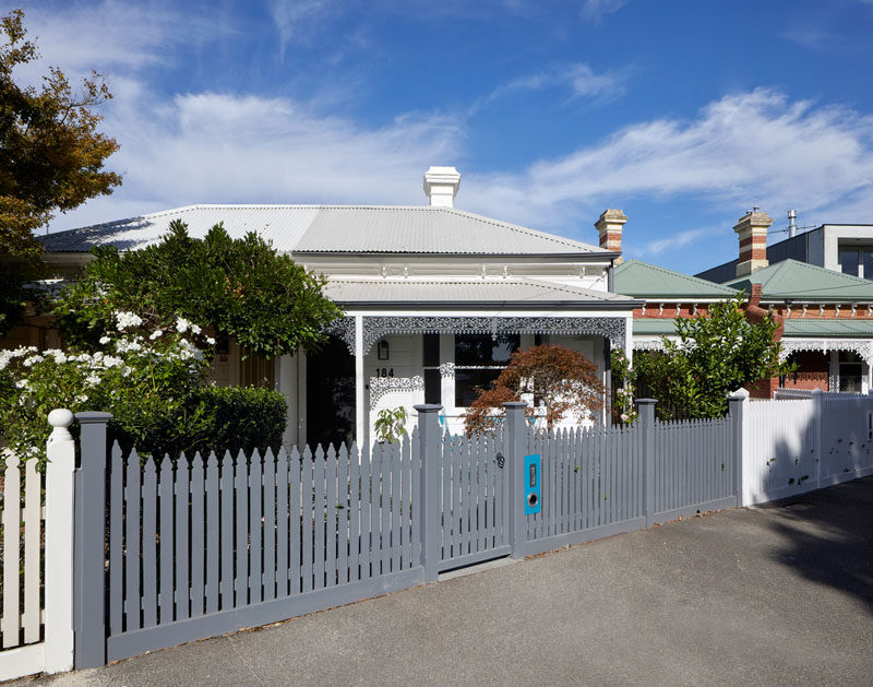 At the front of the house, the fence and ornate iron lacework have been painted to stand out among its neighbors. #CurbAppeal #PaintedFence #AustralianArchitecture