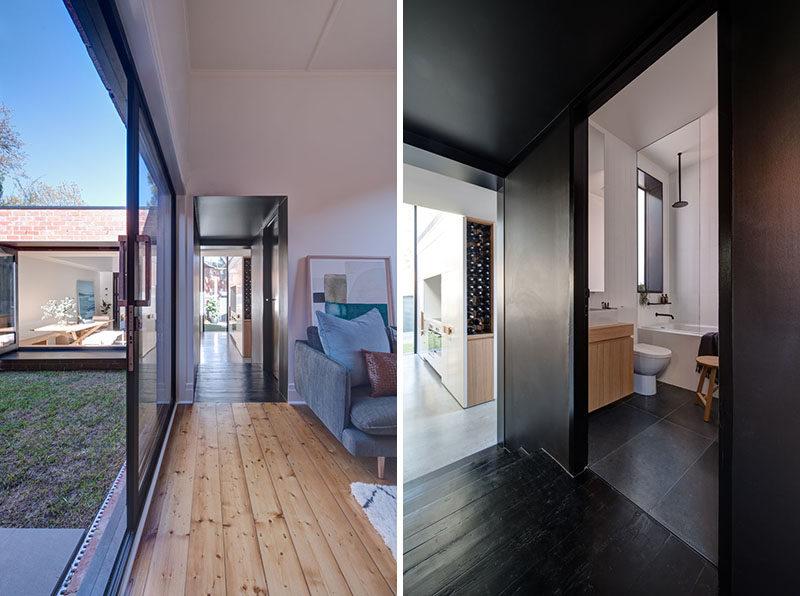 A dark section of this hallway has a matching door that reveals a hidden bathroom. #Hallway #BlackHallway