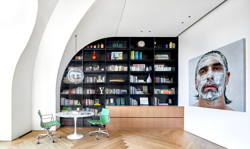 Shelving Ideas - This modern penthouse apartment features custom-designed steel shelving that follows the shape of the ceiling and wall. #Shelving #SteelShelving #Bookshelf