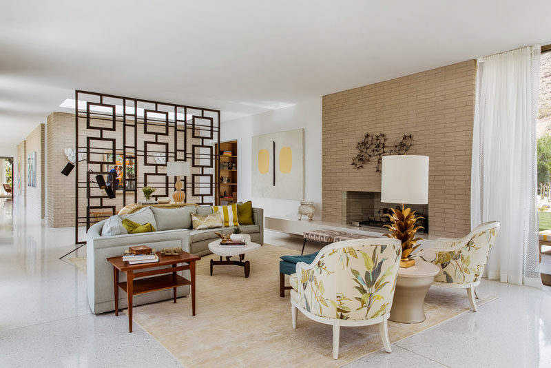 The living room in this renovated house has a new floor that features white terrazzo with amber accents that picks up the warmth of the earth tones found in the landscape surrounding the house. #Flooring #WhiteTerrazzo