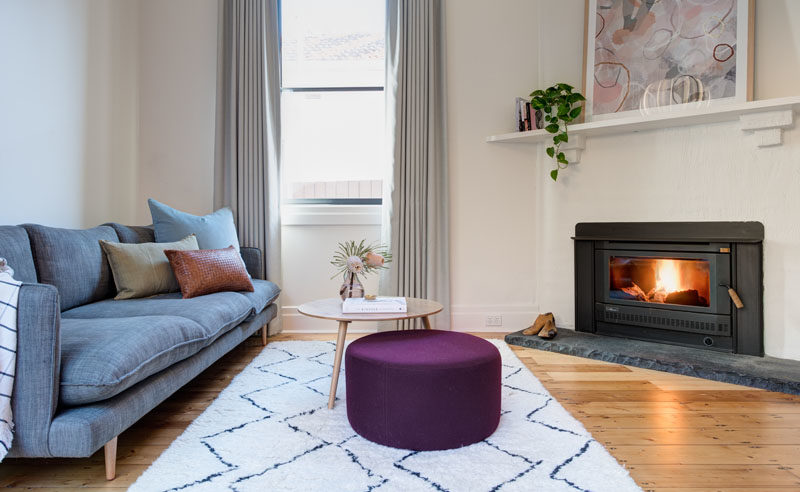 Living Room Ideas - This updated living room has an angled fireplace and a window that adds natural light. #LivingRoomIdeas #Fireplace