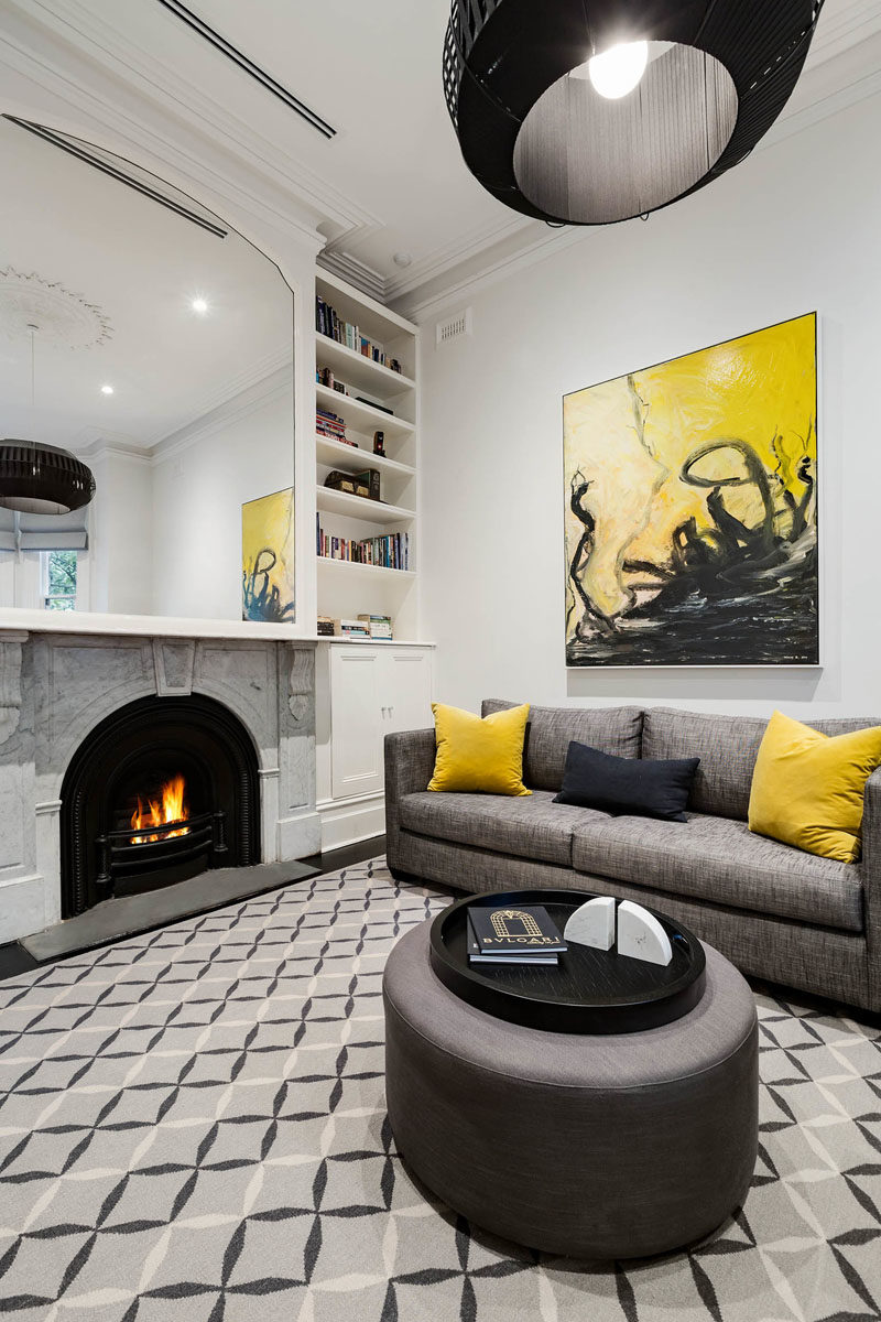 Living Room Ideas - This updated living room stills shows elements of the original Victorian house, like the fireplace and crown moulding. #LivingRoomIdeas #LivingRoom #Fireplace