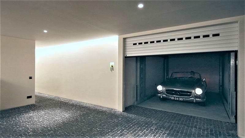 IdealPark has created a system that enables cars to be transported to different levels of the home, much like a lift, moving cars from street level to an underground garage. #CarPark #UndergroundGarage #GarageIdeas #Design #Architecture