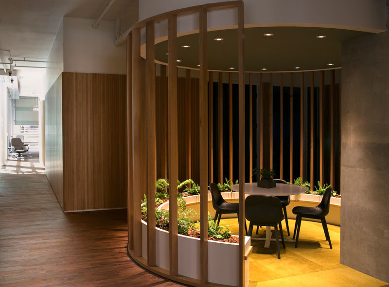 Workplace Ideas - The design of this modern communal seating with planters, was inspired by Fairy Rings found in the forest. #WorkplaceDesign #OfficeDesign #SeatingDesign #CommunalSeating #InteriorDesign