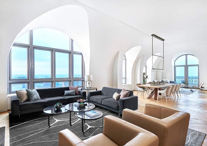 Arched Windows And Vaulted Ceilings Help To Make This A Bright And Open Apartment Interior