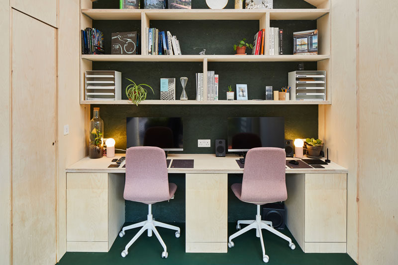 Inside this backyard studio are two work stations that have added to the interior, with open shelving located above, providing much needed storage space. #BackyardStudio #BackyardOffice #GardenStudio