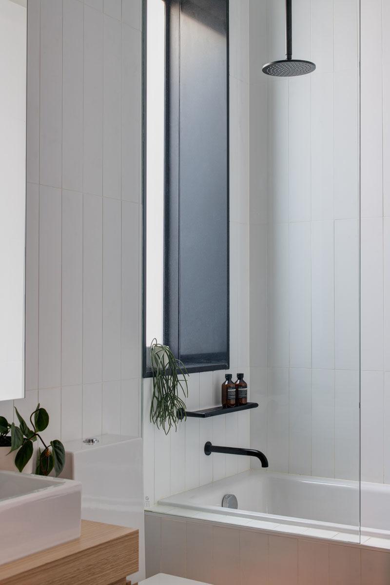 Bathroom Ideas - This modern bathroom features a rainfall shower head and a built-in bath. #Bathroomideas #ModernBathroom