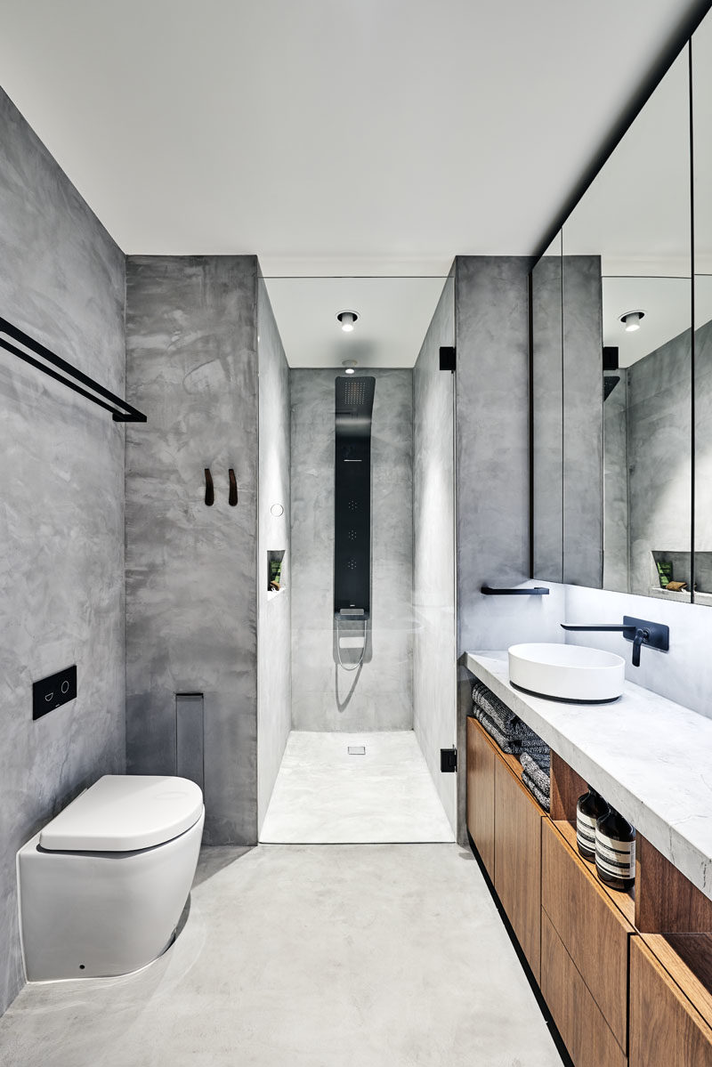 Bathroom Ideas - In this modern bathroom, grey walls have been accented with black, white, and wood elements. #BathroomIdeas #BathroomDesign #ModernBathroom