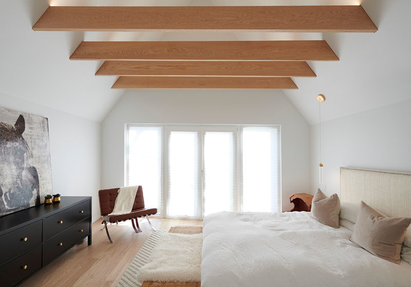 Bedroom Ideas - In the master bedroom, exposed wood beams draw the eye upwards to the height of the ceiling, making the room feel larger. #BedroomDesignIdeas #ExposedBeams #ModernBedroom