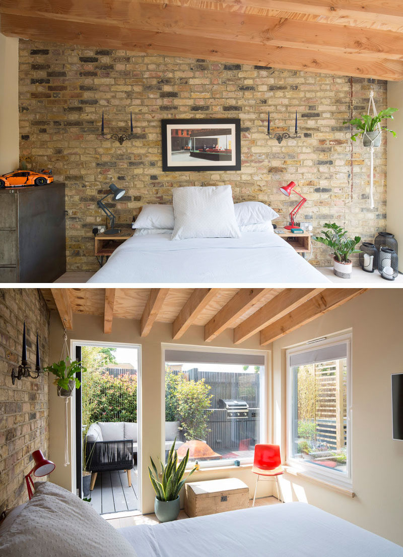 Bedroom Ideas - In this bedroom, a brick wall provides a backdrop for the bed, while wood beams have been left exposed. Windows and a door provide a view of the outdoor lounge and bbq area.