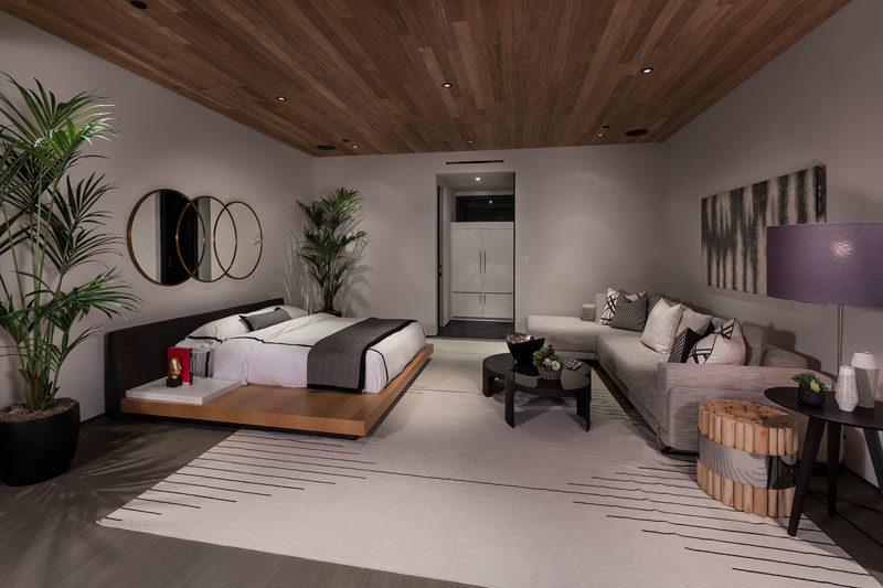 Bedroom Ideas - In this large bedroom, there's space to relax with a couch lining the wall opposite the bed. #BedroomIdeas #LargeBedroom