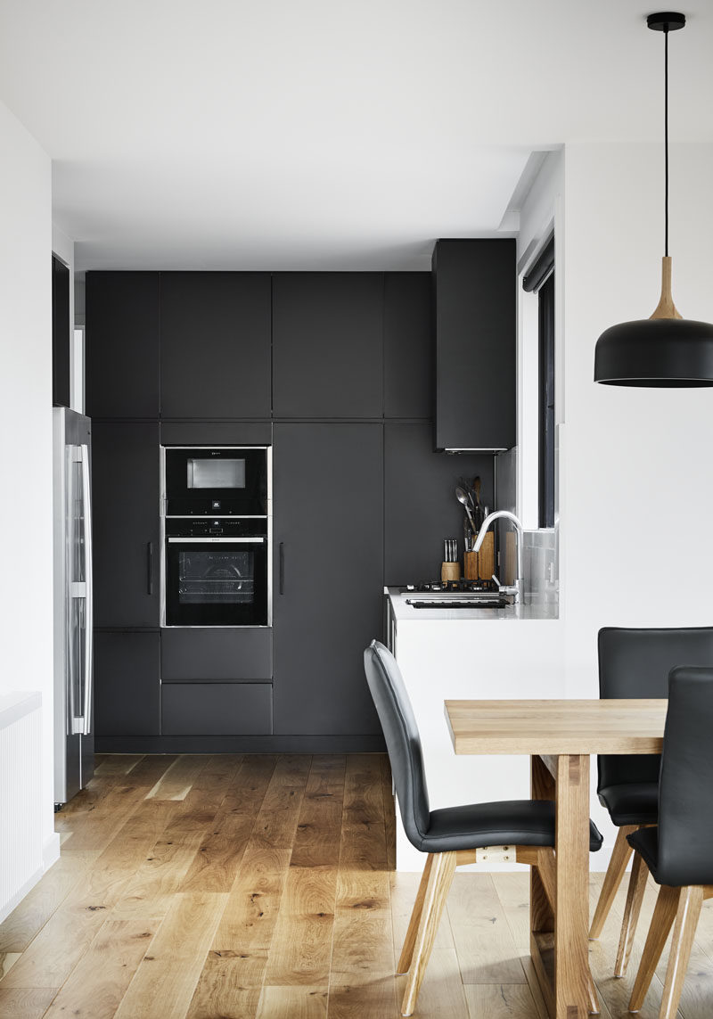 This modern kitchen features a combination of both matte black and white cabinets. #BlackKitchen #ModernKitchen #KitchenDesign