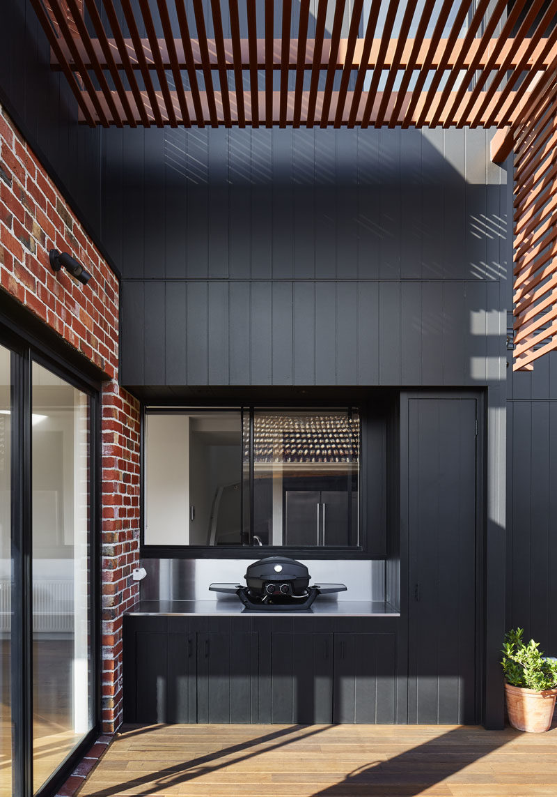 This small deck has a built-in outdoor kitchen with room for a tabletop bbq. #Deck #Pergola #OutdoorKitchen