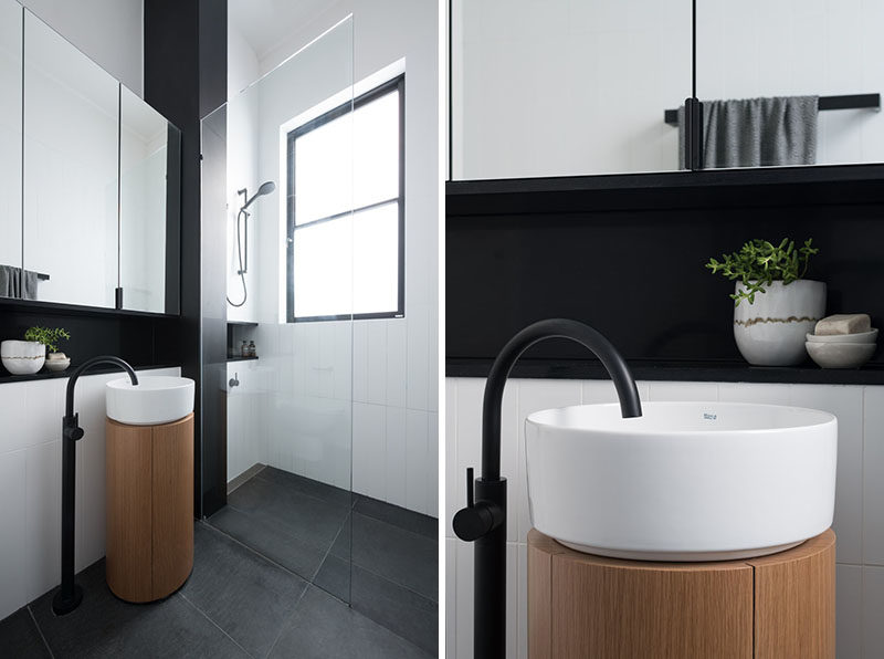 Bathroom Ideas - This modern bathroom has been designed with a minimalist pedestal sink, a walk-in shower, and black accents. #BathroomIdeas #BathroomDesign #ModernBathroom