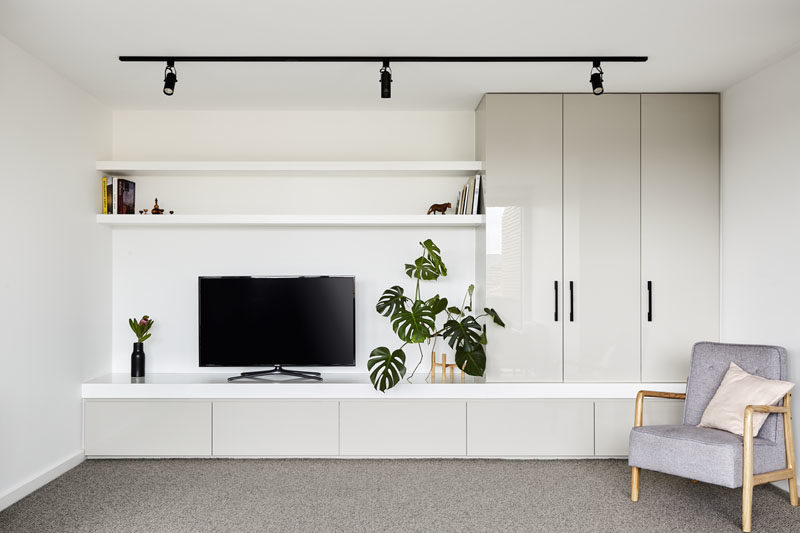This modern rec room (rumpus room) has been designed with built-in cabinetry and open shelving. #RecRoom #RumpusRoom #Cabinets #Shelving