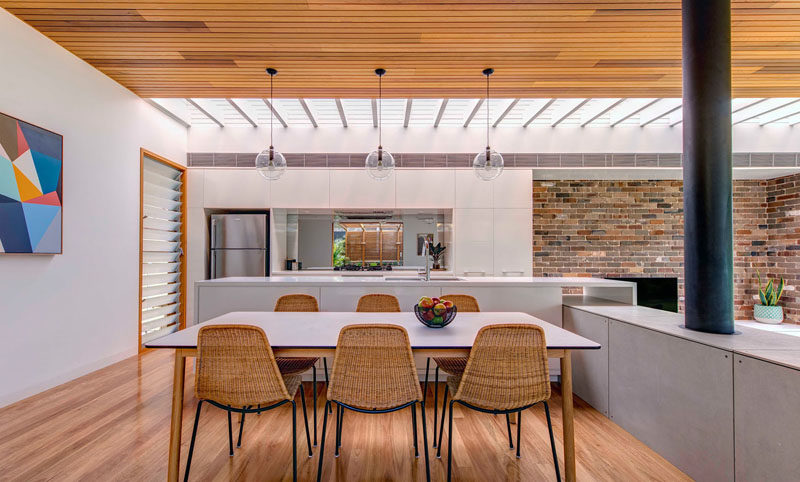 The high ceilings throughout this modern addition are timber lined, to ensure the space feels warm and inviting even in the large open rooms. #WoodCeilings #DiningRoom #ModernHouseAddition