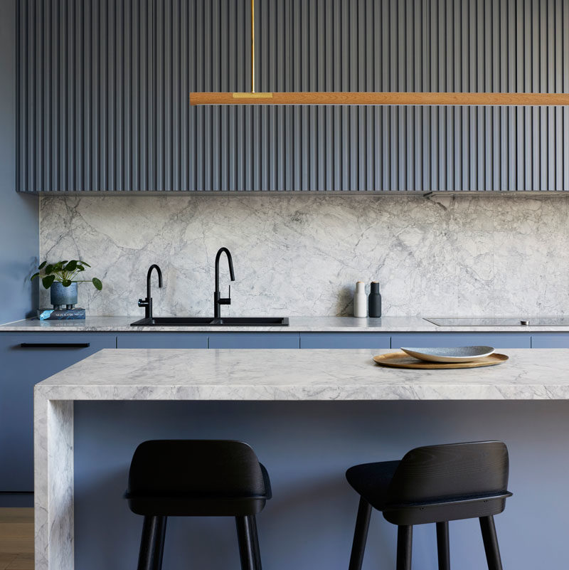 Kitchen Ideas - Blue-grey cabinets have been combined with marble, to create  a modern and eye-catching kitchen. #KitchenIdeas #BlueKitchen #GreyKitchen #KitchenDesign