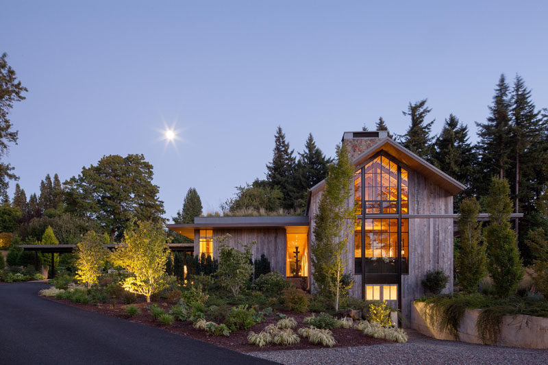 This house, which is reminiscent of a farm structure, is clad in reclaimed barnwood, and has a pitched roof with high windows at each end of the main volume, that flood the home with light. A green roof helps to create an emphasis on integrating the house into its natural surroundings.  #Architecture #FarmhouseModern #GreenRoof #ModernHouse #Landscaping #Windows
