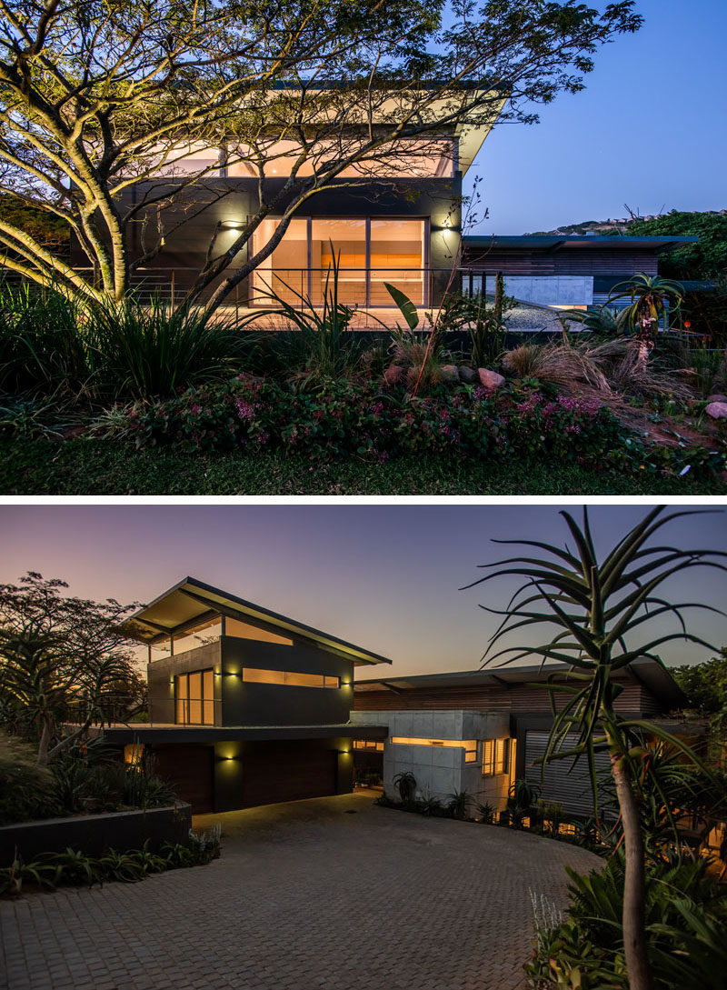 Large established trees and bush surround this modern house, providing privacy and shade. #ModernHouse #ModernArchitecture