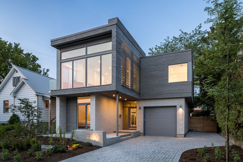 The exterior of this modern house showcases honed concrete-block walls and grey-stained cedar siding. #ModernHouse #ModernArchitecture #ConcreteBlockWalls #CedarSiding #GreyWood