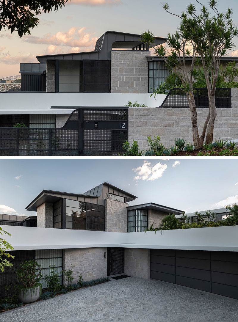 Located on the low side of the street, the house features a lightening shaped zinc roof, while the garage is concealed below a green roof. #Architecture #ZincRoof #ModernHouse
