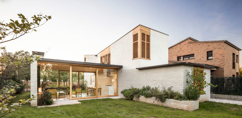 Architecture Ideas - The design of the house includes two volumes, one that is vertical and closed off, which houses the bedrooms, bathrooms, stairs, and storage, while the second volume is horizontal and transparent, meant for entertaining. #Architecture #ModernHouse