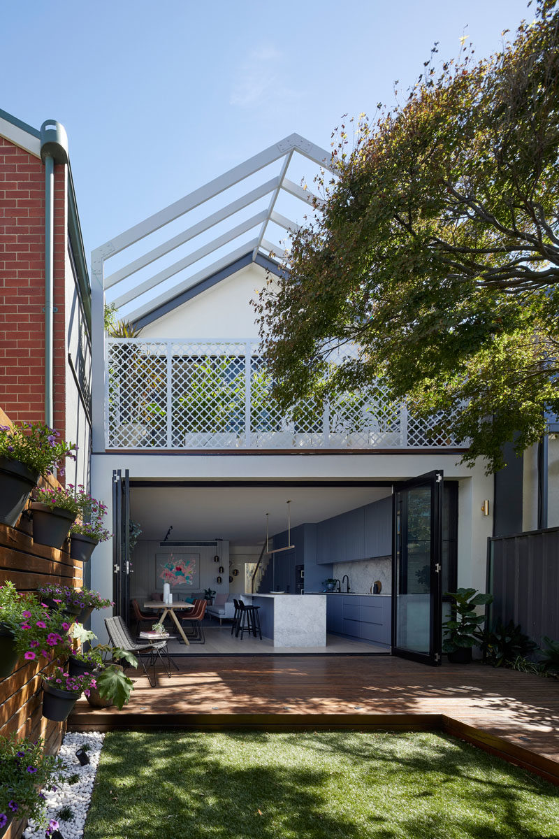 The gable roof form of this modern house addition was left over from a previous renovation in the 90's, however it was retained but extended over the balcony as a pergola to allow plants to eventually grow over and soften the facade. #Pergola #HouseAddition #Deck #Yard