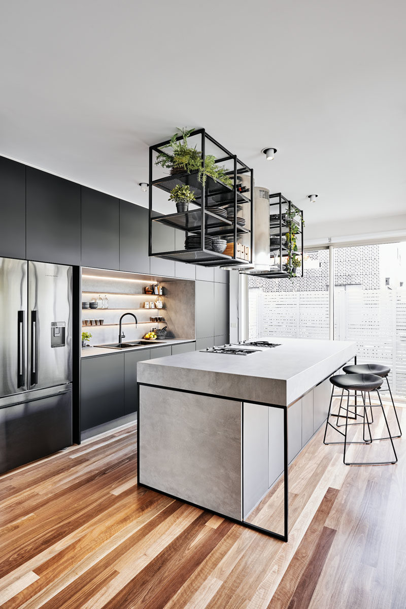 Kitchen Ideas - This modern kitchen serves as the food storage and prep area along with dining, a place for entertaining, and for now, it doubles up as the electronic hub station home office when required. #ModernKitchen #KitchenIdeas