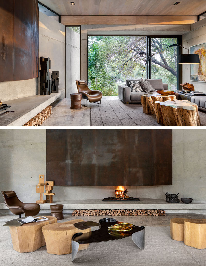Fireplace Ideas - This modern living room has a large fireplace that showcases weathering steel, while space for firewood storage has been created underneath the concrete shelf. #Fireplace #FirewoodStorage #WeatheringSteel #ModernFireplace #FireplaceIdeas