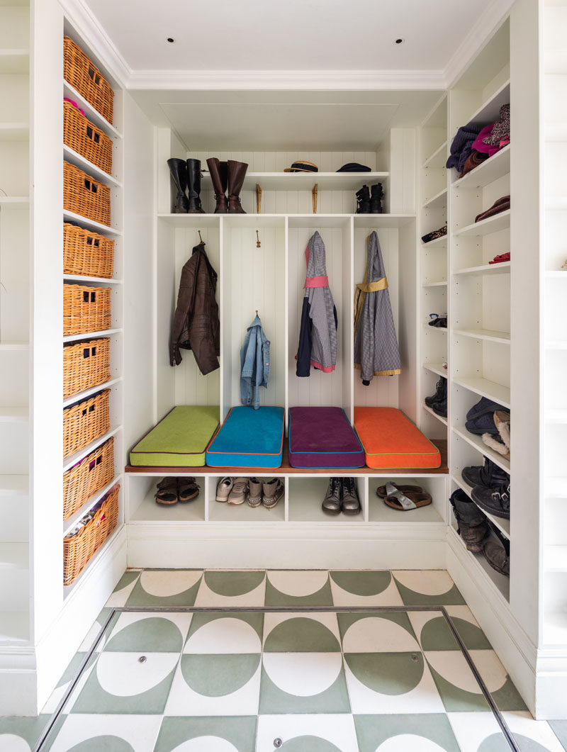 Mudroom Ideas - This modern mudroom features four designated areas with cushioned seating, and plenty of open shelving and basket storage. #MudroomIdeas #Mudroom #BootRoom #InteriorDesign #ShoeStorage