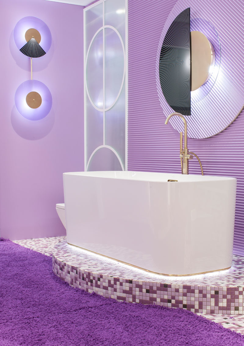 Bathroom Ideas - This modern purple bathroom has been entirely designed with pieces from the Finion series by Villeroy & Boch, while the brass taps are from Oioli. #PurpleBathroom #BathroomIdeas
