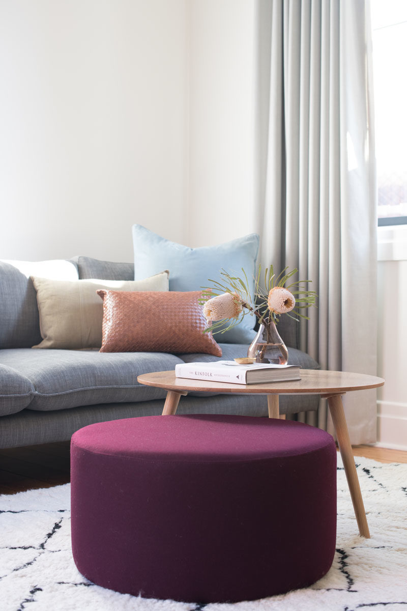 Living Room Ideas - Soft colors and a bold purple accent create a relaxing living room that's also fun. #LivingRoomIdeas #LivingRoomFurniture #LivingRoom
